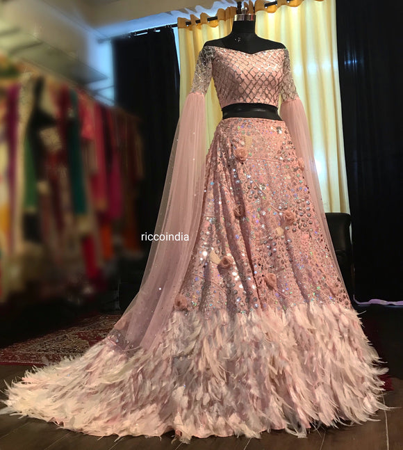 Baby pink train feather Lehenga with cape sleeves