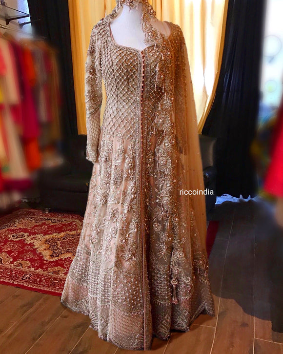 Intricate embroidery jacket Lehenga in champagne gold