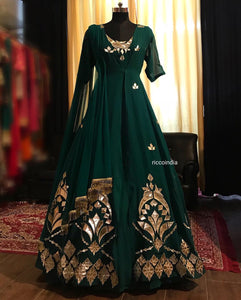 Emerald green leather jacket with green gown and fringe dupatta