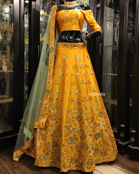 Mustard and mint green heavily beaded Lehenga