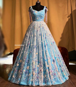 Aqua blue ball gown with tassel sleeves