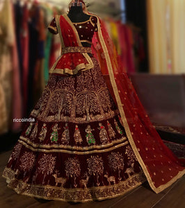 Maroon velvet bridal Lehenga with baraat figurines