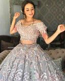 Custom bridal Lehenga in pastel grey with peach and aqua intricate embroidery