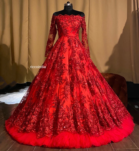 Red layered structured gown with red beadwork