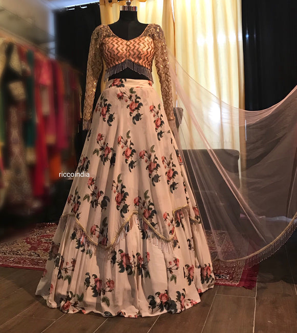 Peach Aztec embroidery blouse with floral layered lehenga