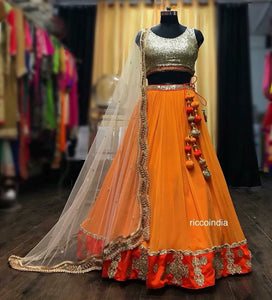 Sequin work top and flared orange skirt with curved border dabka work dupatta