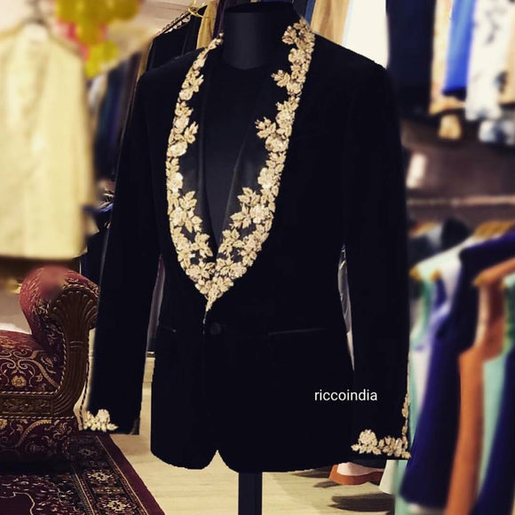 Black tuxedo with intricate embroidery lapel