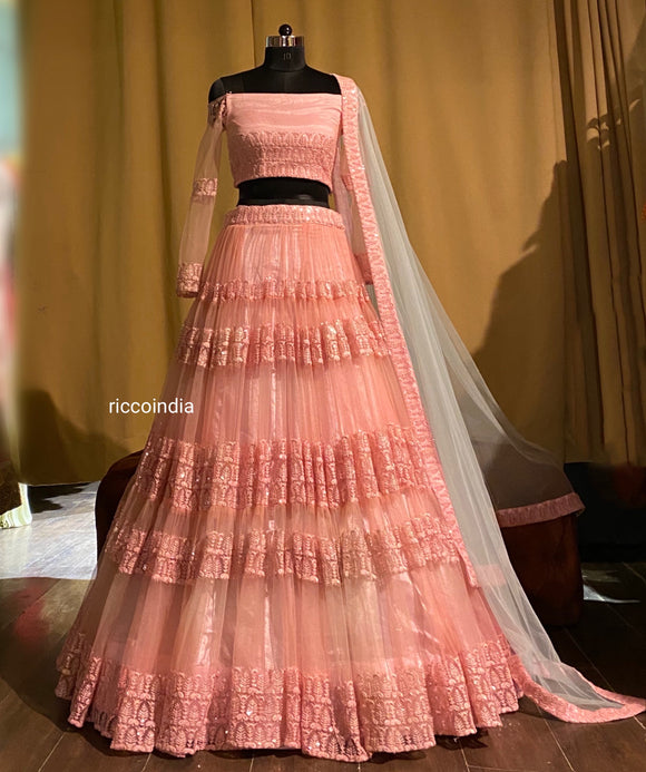 Pink ruffled lehenga with aqua dupatta