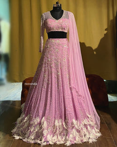 Purple lehenga with feathers