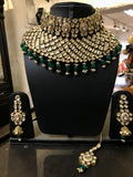 Pure polki necklace with emerald stones