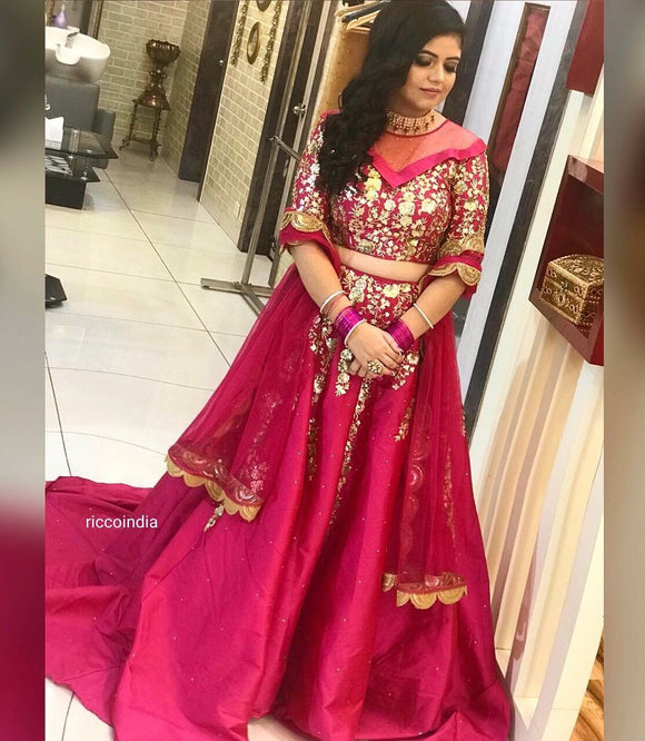 Pink long train Lehenga with concept neckline