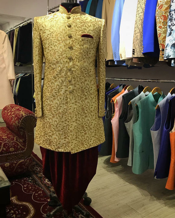 Gold embroidered sherwani with maroon dhoti