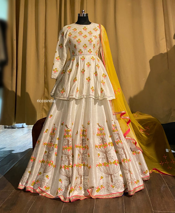 White peplum lehenga with Resham and dori work