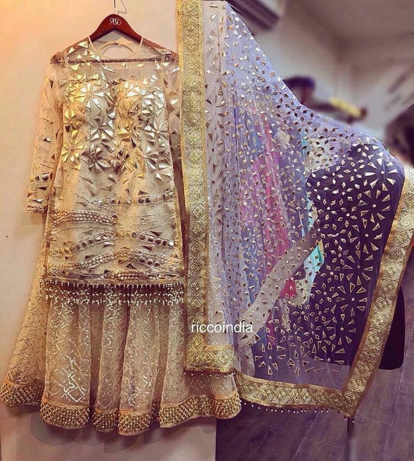 Leather and gota work gold sharara with heavy dupatta