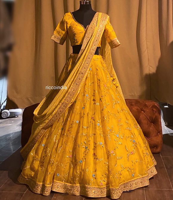 Pastel yellow organza flared lehenga with stripe dupatta