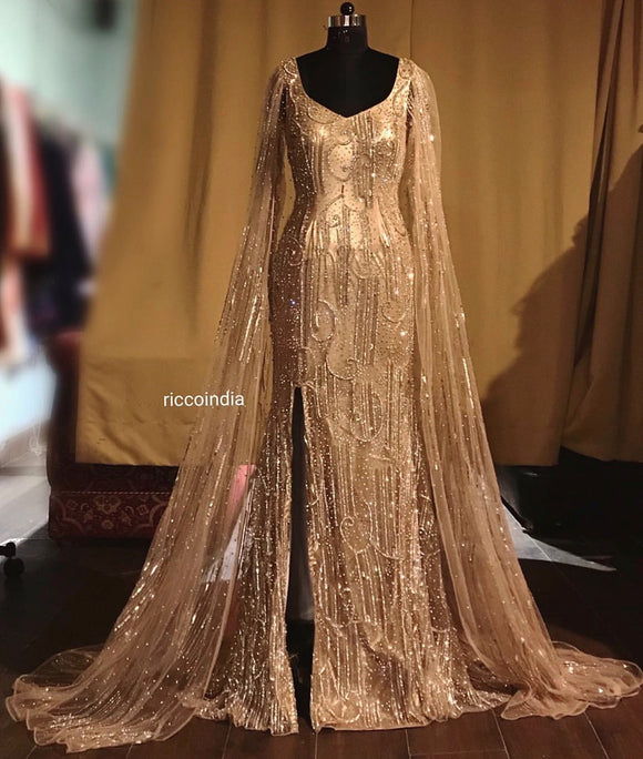 Mermaid gold couture gown with cape