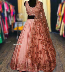 Peach Lehenga with heavy embroidered dupatta