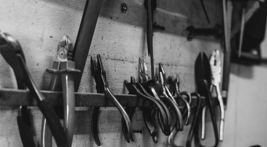 A black and white photograph of tools found in an ethical jewellery workshop