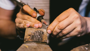 A craftsman creating one of our exceptional jewellery pieces.