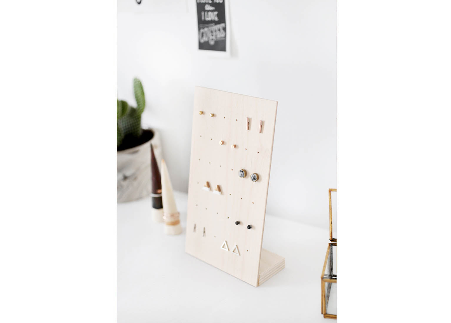 A beautiful photograph of a quirky wooden earring holder/stand.