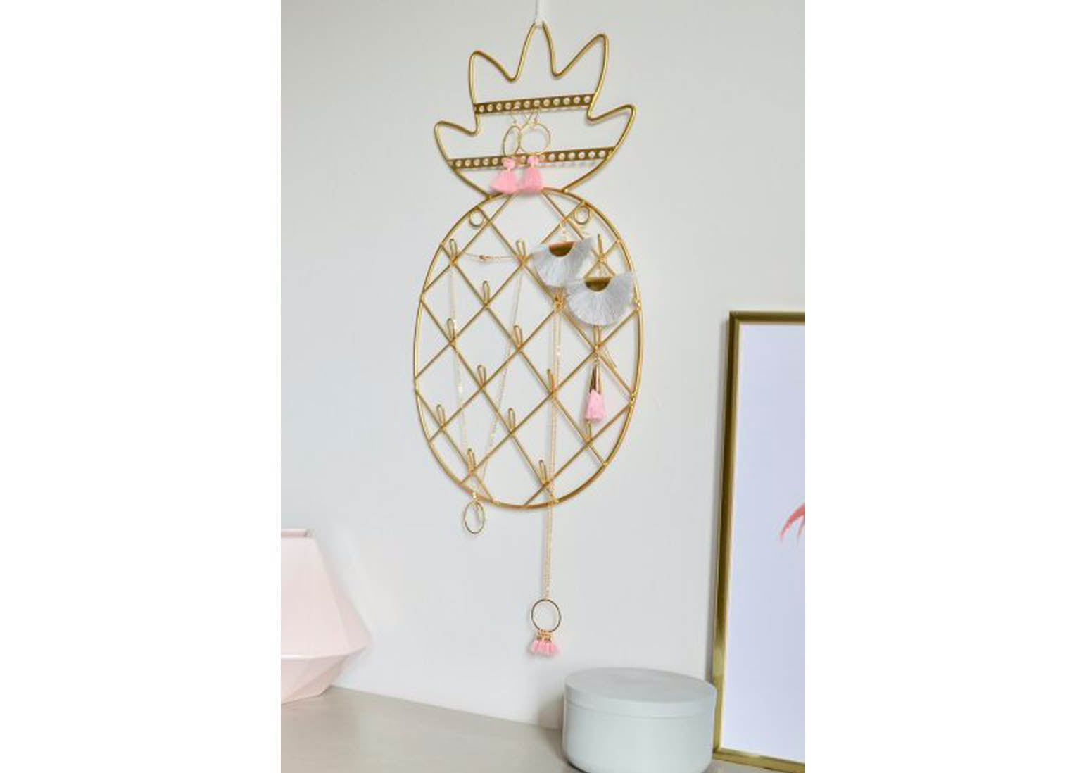 A beautiful photograph of a unique pineapple jewellery holder. This fun and quirky design is from not a jewellery box