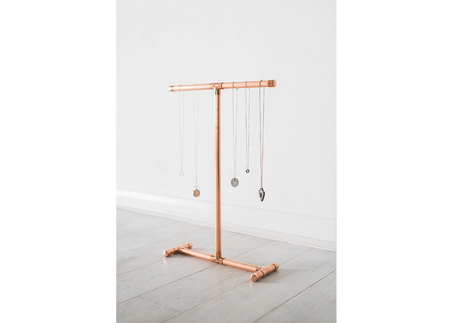 A beautiful photograph of a unique copper necklace stand by notonthehighstreet.com