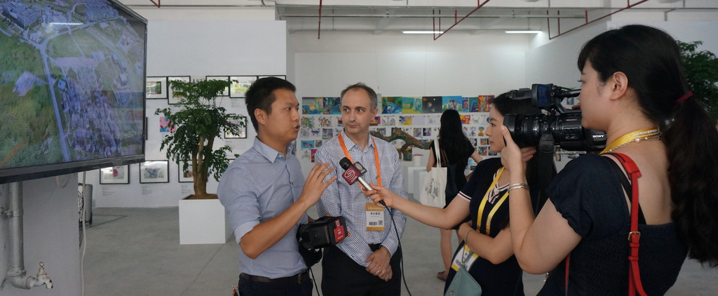 Dr. Alex Han (left) and Mark Richardson, Associate and South China Architecture and Planning Leader at Arup, were interviewed by local media at the Pingdi exhibition.