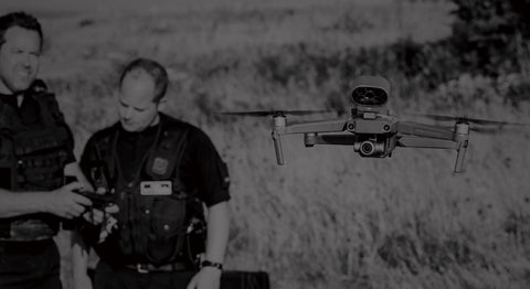 Two drone operators deploy a DJI Mavic 2 Enterprise drone for search and rescue operations