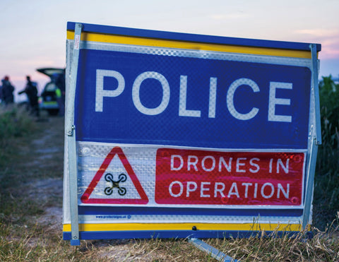 Police signage warning persons in the vicinity that drones are in operation