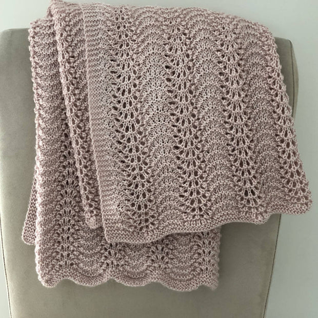 Hand knitted square lace baby shawl in dusty pink