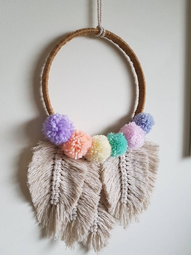 Macrame feather and pom-pom hoop