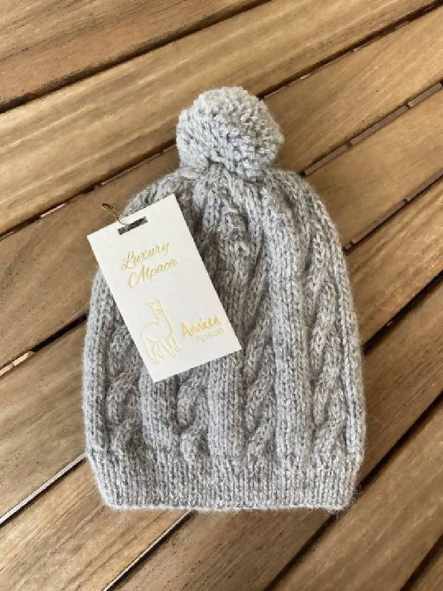 Hand knitted cable beanie