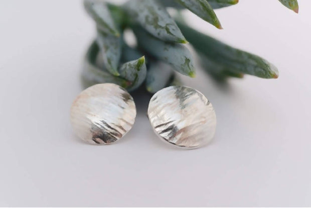Domed sterling silver earrings with hammered texture