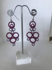Purple quilled earrings made from paper.