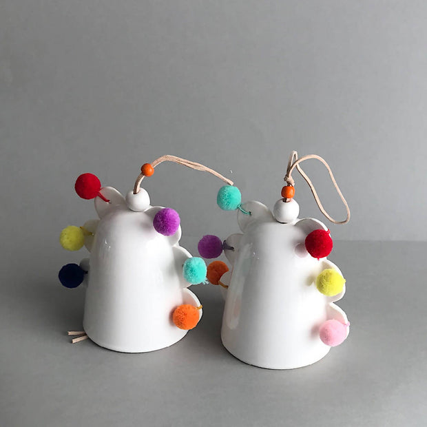 Handmade ceramic bell with pom poms