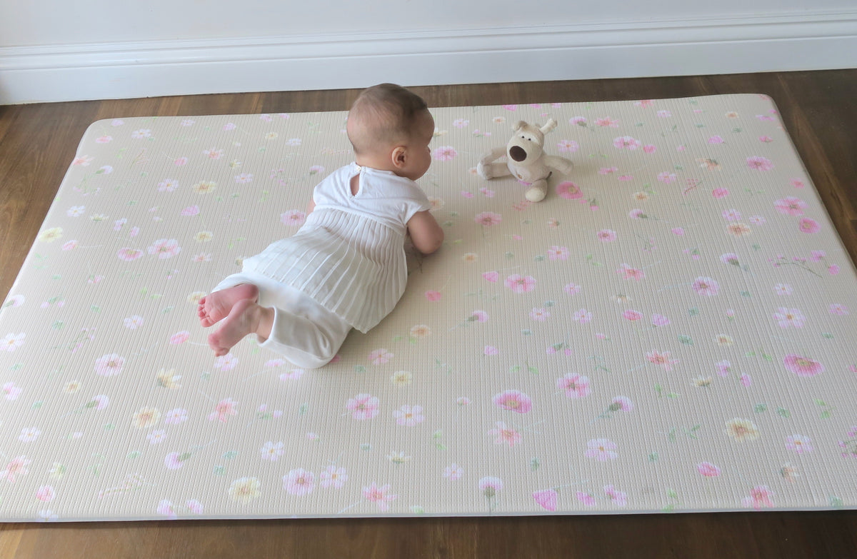 thick reversible waterproof padded play mat for baby. 1.5cm memory foam core. Anit bacterial, eco friendly non toxic surface. Perfect for tummy time.