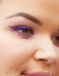 Katie wearing the Purple Reign Winged Eyeliner Stamp. Close up of eye.