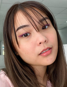 Sara wearing Purple Reign Winged Eyeliner Stamp.