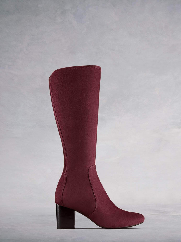 Avocet, our burgundy suede women's knee high boots with a mid-height block heel. Available in a wide range of calf sizes.