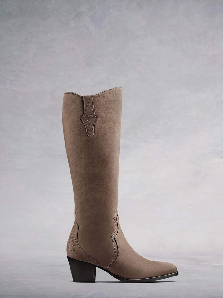 Buckland, our elegant Western-inspired knee high boot crafted from taupe nubuck leather with intricate detailing. Available in a wide range of calf sizes.