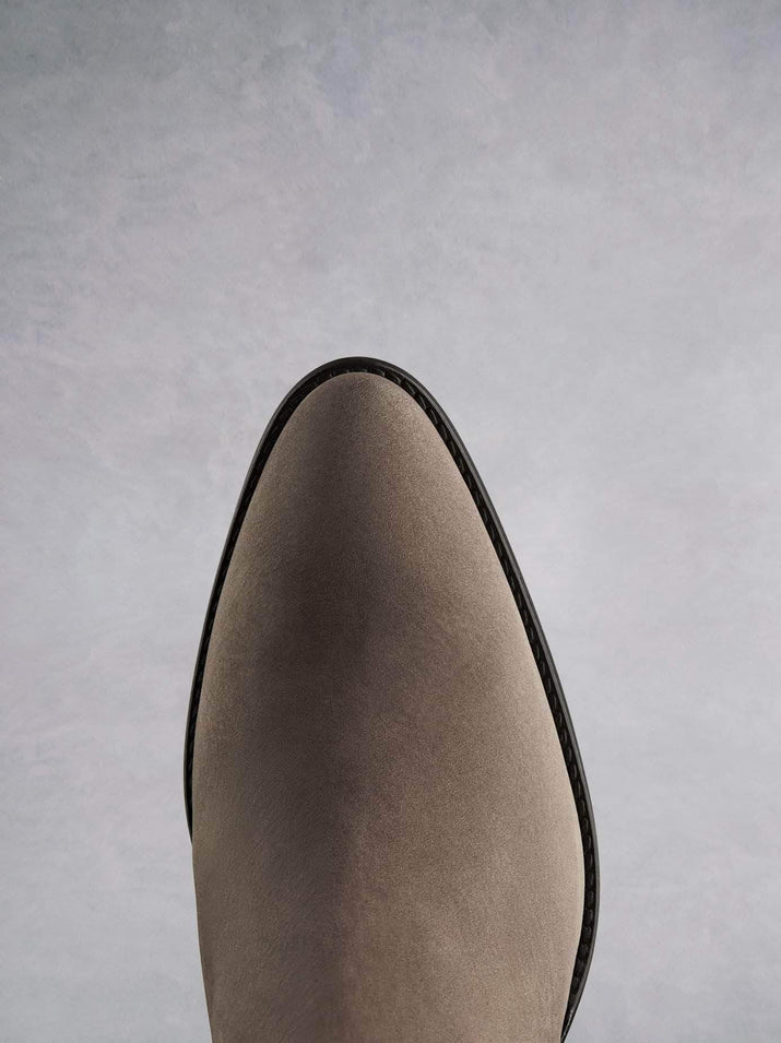 Buckland in taupe features a stylish pointed toe shape inspired by the western style.