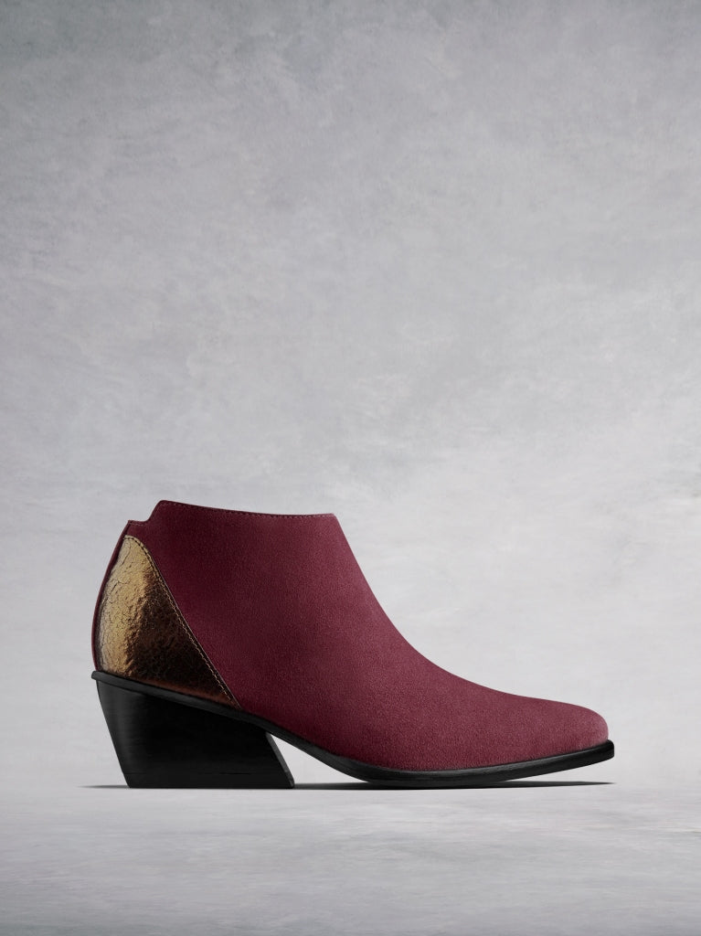 Buell, our burgundy suede low-cut ankle boot with a metallic counter.