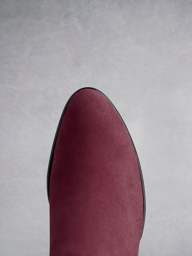 Buell burgundy features an almond toe shape, offset by a unique angular heel.