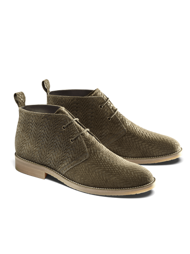 Our Delmore desert boot in khaki embossed suede has laces and a low block heel.