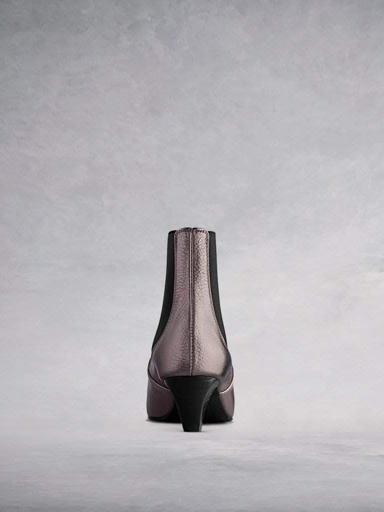 This pewter ankle boot features a slim, square shaped, low Italian heel.