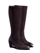 Feltham, a classic knee high boot has an almond toe and a mid-height Cuban heel.