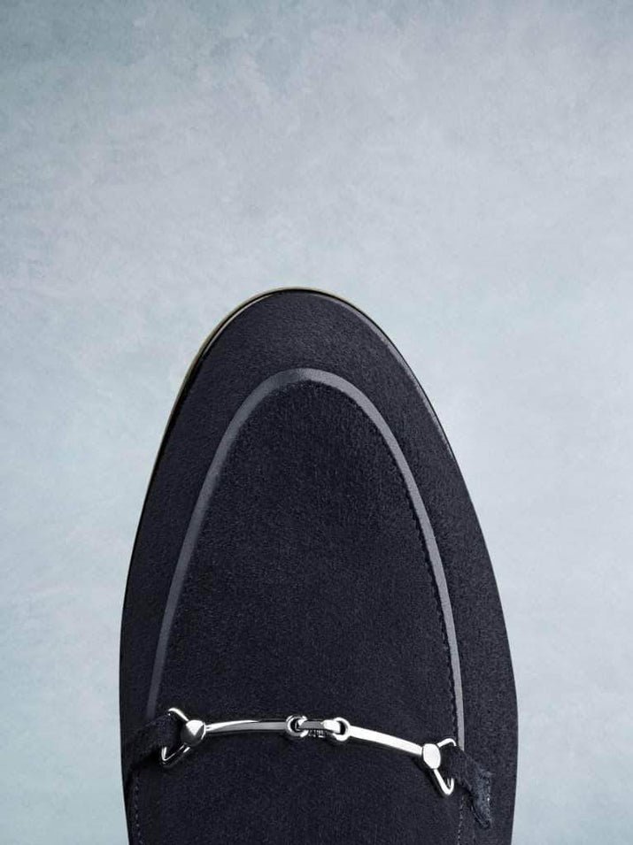 Fistral navy suede features a gentle almond toe shape.