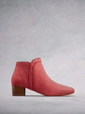 Florencia, our coral pink suede ankle boot with a scalloped edged trim.
