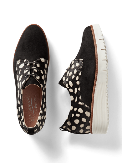 Hayle, our lace-up brogue flatform shoe with black and white spot hair leather.