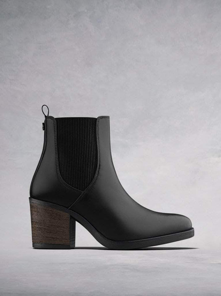 Isidor, our black leather high heeled Chelsea boot with textured elastic.